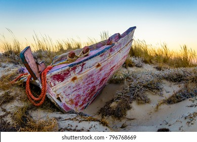 Bleeding body. An abandoned boat at Plaka beach, Naxos, Greece, in the dusk.