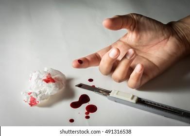 Bleeding finger from cutter knife.