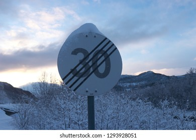 BLEIKNES, NORDLAND COUNTY / NORWAY - JANUARY 19 2019: 30 speed limit cancel road sign in Norway. Road travel by car in Scandinavia