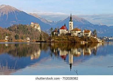 Blejski Otok, Lake Bled, Slovenia, featuring the church, lake, reflections, mountains.