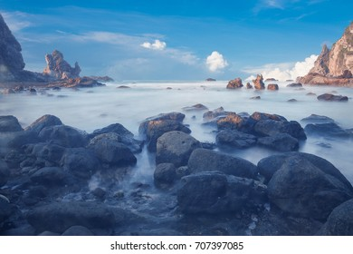a blend of beautiful rock and sky on the beach