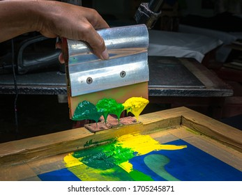 blend color in green tone by dark green light green and yellow then stir with handle printer