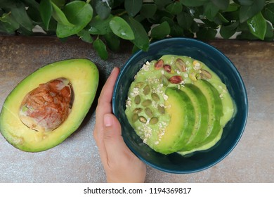 blended avocado with avocado and watermelon seed topping