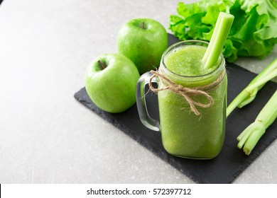 Blended green smoothie with ingredients. Superfood, detox and healthy concept. selective focus.