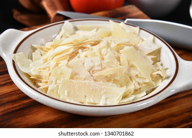 Blended parmesan, asiago and romano cheeses in a small bowl
