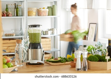 Blender and avocado on the worktop in vegan eco kitchen