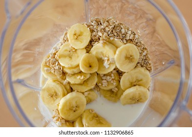 blender with bananas, oats and milk. healthy food. vegetarian food. healthy vitamin.