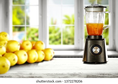 Blender in kitchen with white wooden window space. Free space for your decoration and lemon fruits