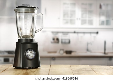 blender and wooden table in kitchen