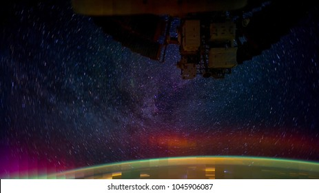 Blending composition from Time Lapse sequence - Space satellite orbiting the earth with back ground of star trail on  burst motion. Elements of this image furnished by NASA.