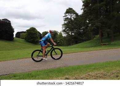 Blenheim Bloodwise Triathlon, Oxfordshire,Uk, june 2 2019: Age Group Weekend Warrior Triathlete on the bike course at Blenheim Palace.