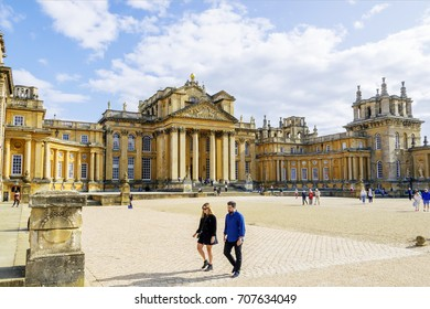 Blenheim Palace, OXFORD, UNITED KINGDOM - AUGUST 19, 2017: A view of Blenheim Palace and its front courtyard during a clear sky sunny day.