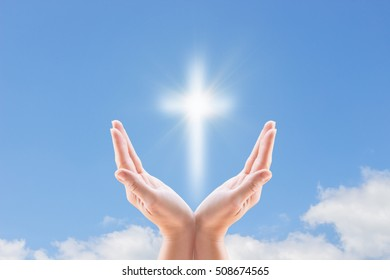 Bless the cross in the sky. A cross and hands