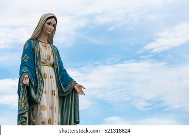 The Blessed Virgin Mary in the blue sky.