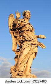 Blessing angel statue in Saint Angel bridge. Rome, Italy
