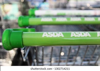 Bletchley, Buckinghamshire / UK - February 2, 2019: Close up of ASDA logo on shopping cart.
