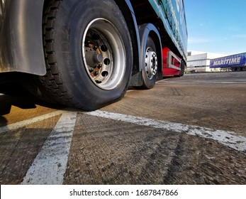 Bletchley, Milton Keynes / UK - March 23 2020: Semi Truck with a Puncture on the Nearside Drive Wheel.