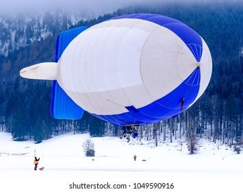 blimp (hot air airship) flying at the european alps
