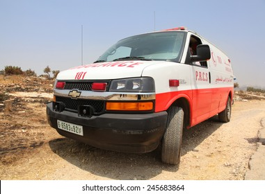 B'LIN, PALESTINE - CIRCA JUNE 2012:  Palestinian ambulance evacuates casualties  following confrontation between Palestinian protesters and Israeli security forces