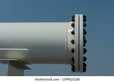 The blind flange is installed at the end of the pipe system with a pipe support.
