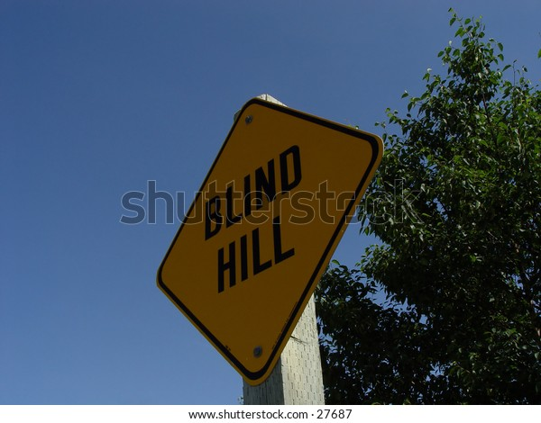 Blind Hill Sign with trees and blue sky as background