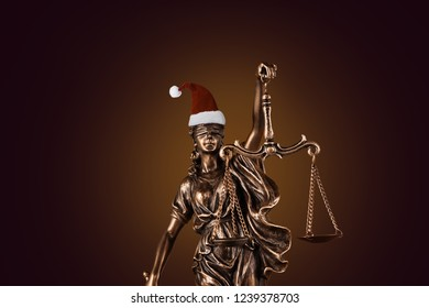 Blind Justitia with Santa hat for Christmas
