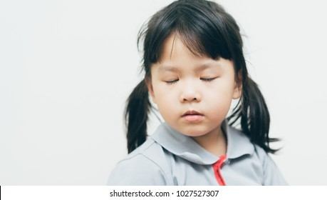 Blind little girl.Little girl close eyes.Blind person.