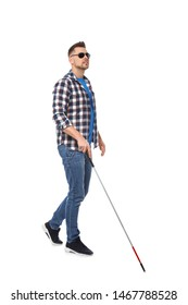 Blind man in dark glasses with walking cane on white background