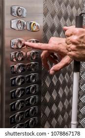 Blind man inside an elevator.