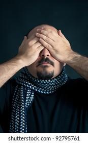 Blind Man portrait on dark background.