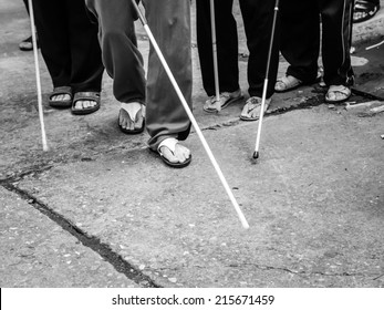 blind 's feet with stick