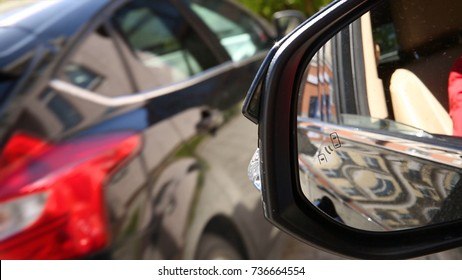 Blind Spot Monitoring system warning light icon in side view mirror of a modern vehicle. system blind spots of the car