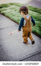 Blind or Visually Impaired Child/Kid/Toddler/Preschooler/Boy Walking Through Neighborhood with Long White Cane; Back to Camera #2