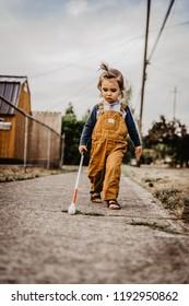 Blind or Visually Impaired Child/Kid/Toddler/Preschooler/Boy Walking Through Neighborhood with Long White Cane, #1