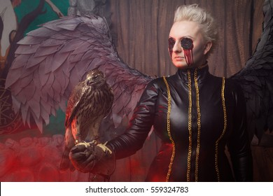 Blind Woman With Big Blackhawk Bird and Huge Wings