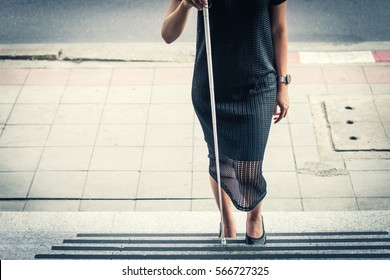 The blind woman walking up the ladder