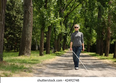 blind woman walking in a park