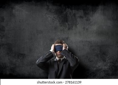 Blindfold businessman