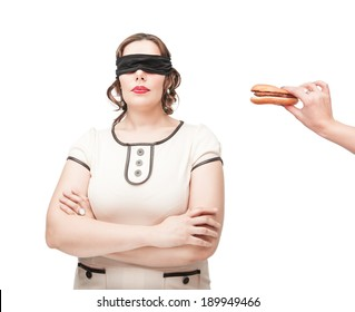 Blindfold plus size woman temptating with hamburger