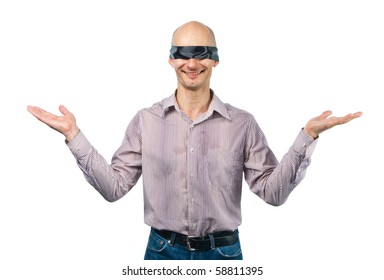 Blindfolded man throws up his hands