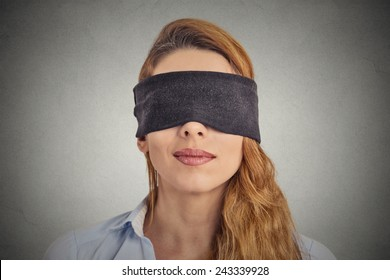 Blindfolded red haired woman