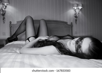 blindfolded sexy woman lying in bed