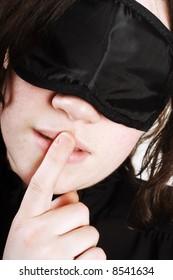 Blindfolded women being secretive