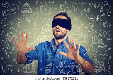 Blindfolded young business man searching walking through complicated social media financial data plan. Sightless entrepreneur analyst managing corporate unknown  financial economy risk concept