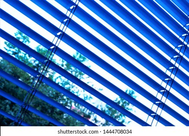 Blinds are effective light protection devices made of vertical or horizontal slats. Slats can be fixed or rotated, regulate light and air flow. Blinds are popular in residential, office and industrial