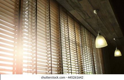 Blinds in a home catching the sunlight with burst light