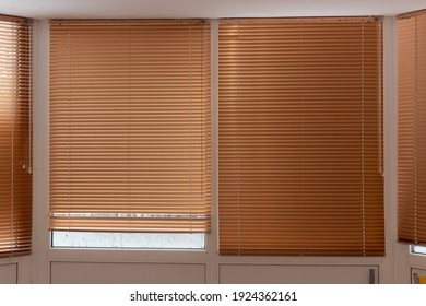 Blinds horizontal brown on the windows. Blinds for summer cottages.
