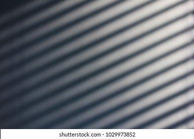 Blinds making shadows on the wall