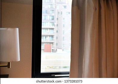Blinds window decoration of room with sunrise in morning, view of blind with glass window that having building behind background , blind in room for protect from sun lighting