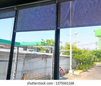 Blinds window decoration of building with sunrise in morning, view of blind with glass window that having building behind background , blind in room for protect from sun lighting